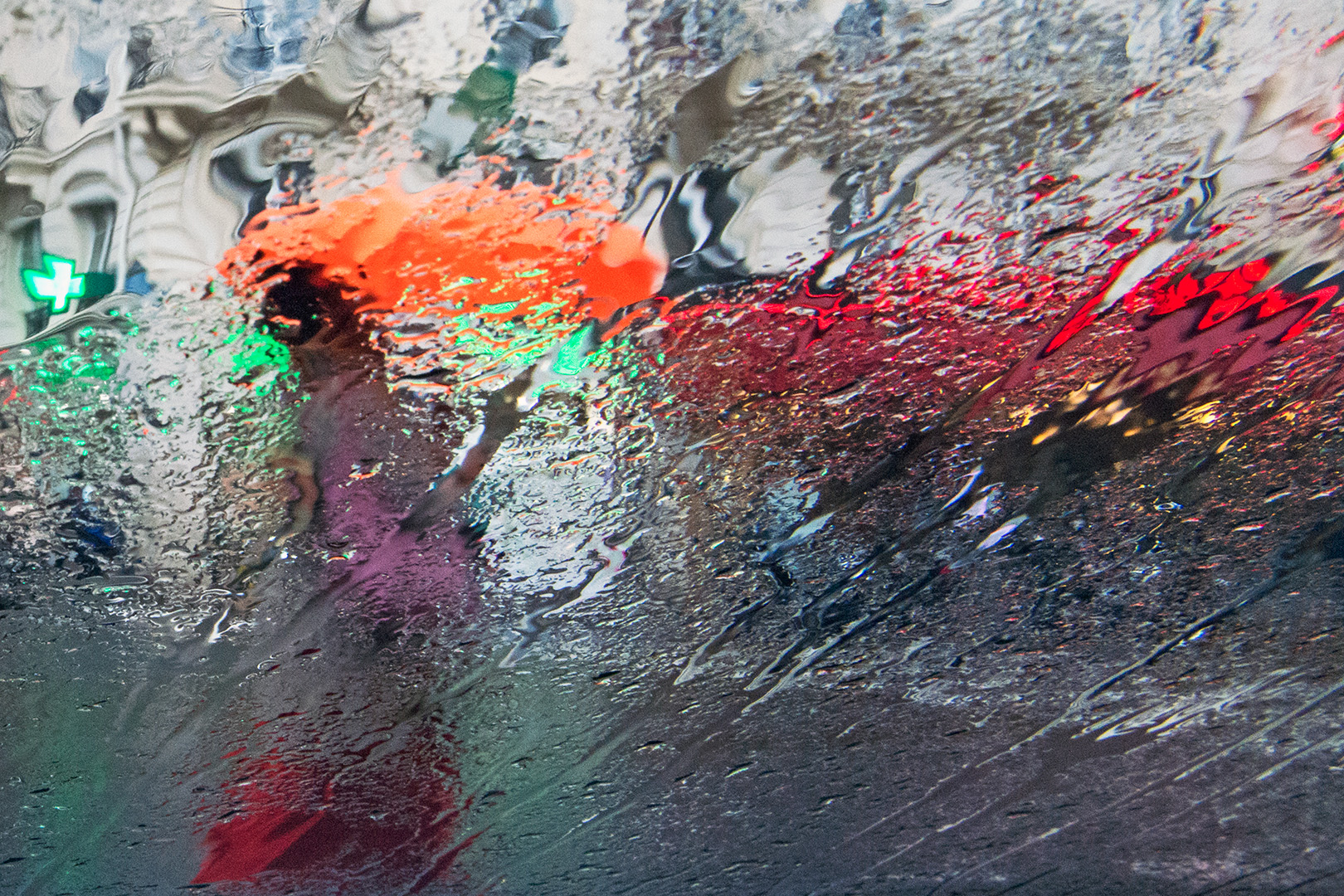 An impressionnist photography, an urban landscape, the lines distorted by a rain curtain